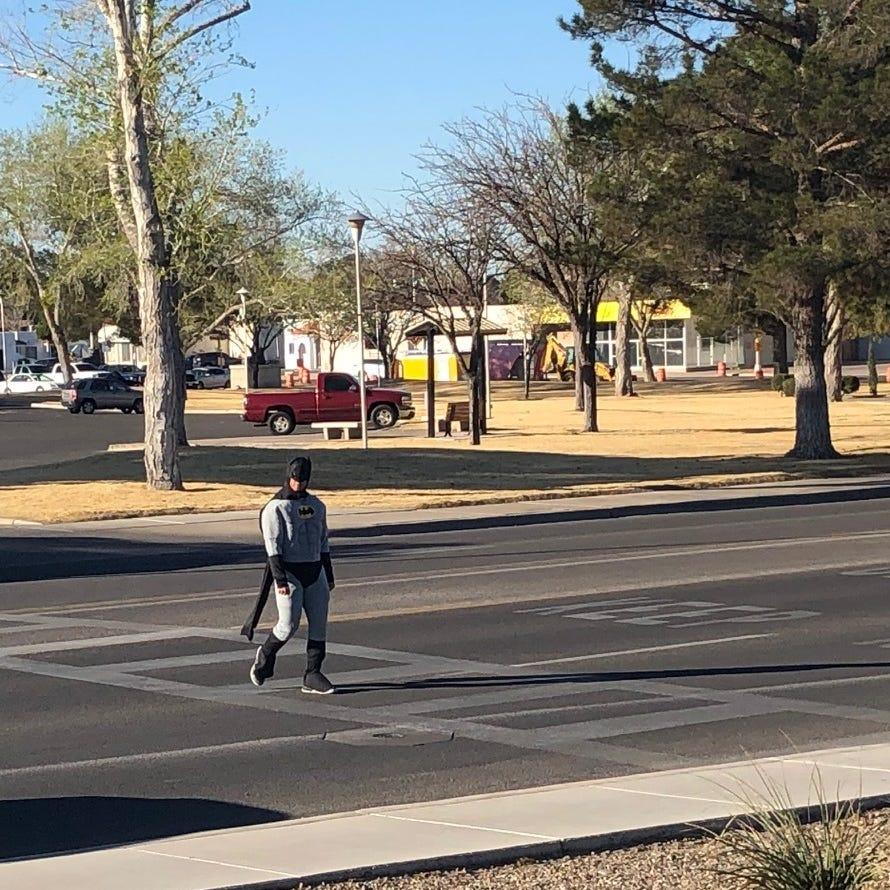 Cops wearing superhero costumes ticket drivers at crosswalks