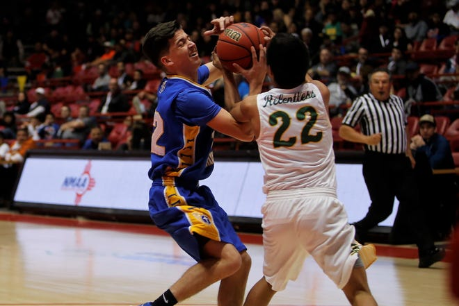 Mesilla Valley's Michael Johnson and Newcomb's Deondre Begay fight for the ball during Friday's 2A state semifinals at Dreamstyle Arena in Albuquerque.