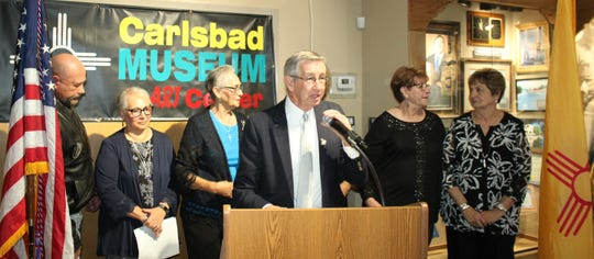 Carlsbad Mayor Dale Janway gathers with members of Cruz Fernandez's family during an induction into the Carlsbad Hall of Fame March 15.