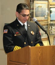 Brian Mendoza, an assistant chief with the Carlsbad Fire Department, speaks about his grandfather Cruz Fernandez during a Carlsbad Hall of Fame induction speech March 15.