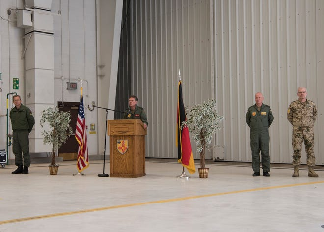Col. Werner Theisen, German Air Force Tactical Training USA Command commander (middle), gives a speech, March 13, 2019, in the GAF hangers on Holloman Air Force Base, N.M. Theisen will lead the remaining German personnel as they disperse to Sheppard Air Force Base, Texas.