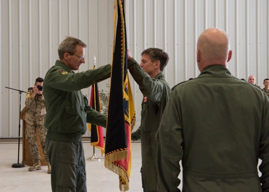 Maj. Gen. Dr. Jan Kuebart, German Air Force Flying Unit's commander, passes the flag to Col. Werner Theisen, GAF Tactical Training USA Command commander, March 13, 2019, on Holloman Air Force Base, N.M. Theisen will continue the process of moving German soldiers to Sheppard Air Force Base, Texas.