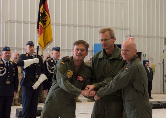 From left to right: Col. Werner Theisen, German Air Force Tactical Training USA Command commander, Maj. Gen. Dr. Jan Kuebart, GAF Flying Unit's commander and Col. Stephan Breidenbach, prior GAF Tactical Training USA Command commander, pose for a picture, March 13, 2019, on Holloman Air Force Base, N.M. Theisen will continue the process of moving German soldiers to Sheppard Air Force Base, Texas.