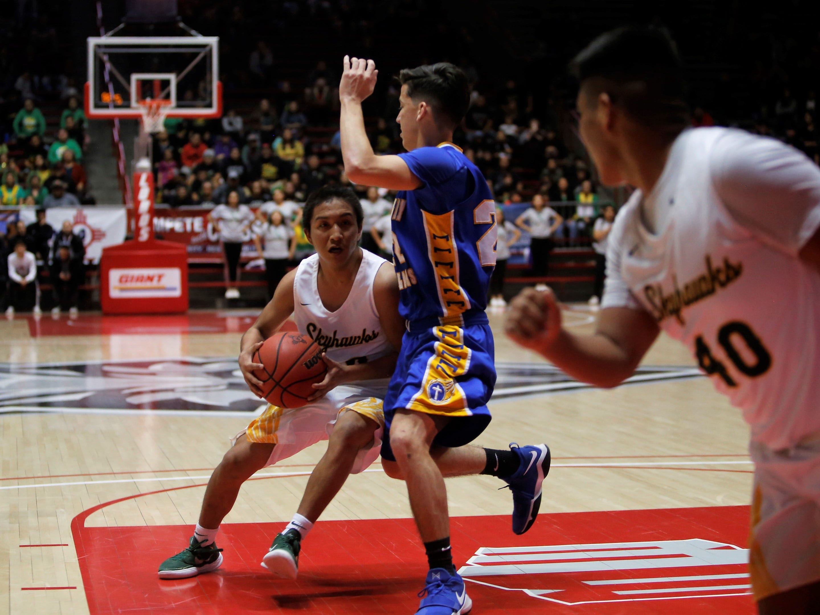 Newcomb's Deondre Begay attacks the basket against Mesilla Valley's Michael Johnson during Friday's 2A state semifinals at Dreamstyle Arena in Albuquerque.