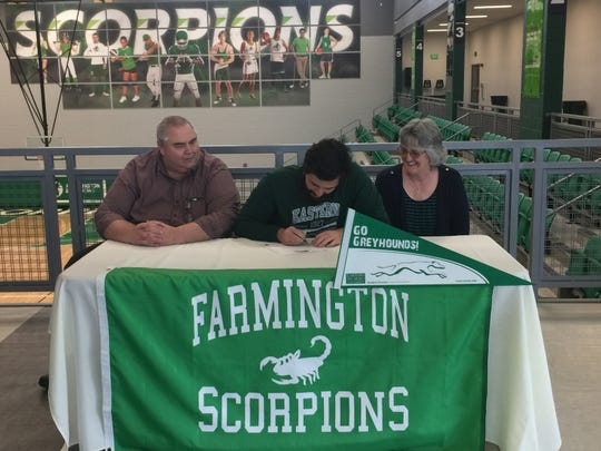 Farmington's James Schryver signs his national letter of intent on Thursday to continue his soccer career at NCAA Division II Eastern New Mexico University.