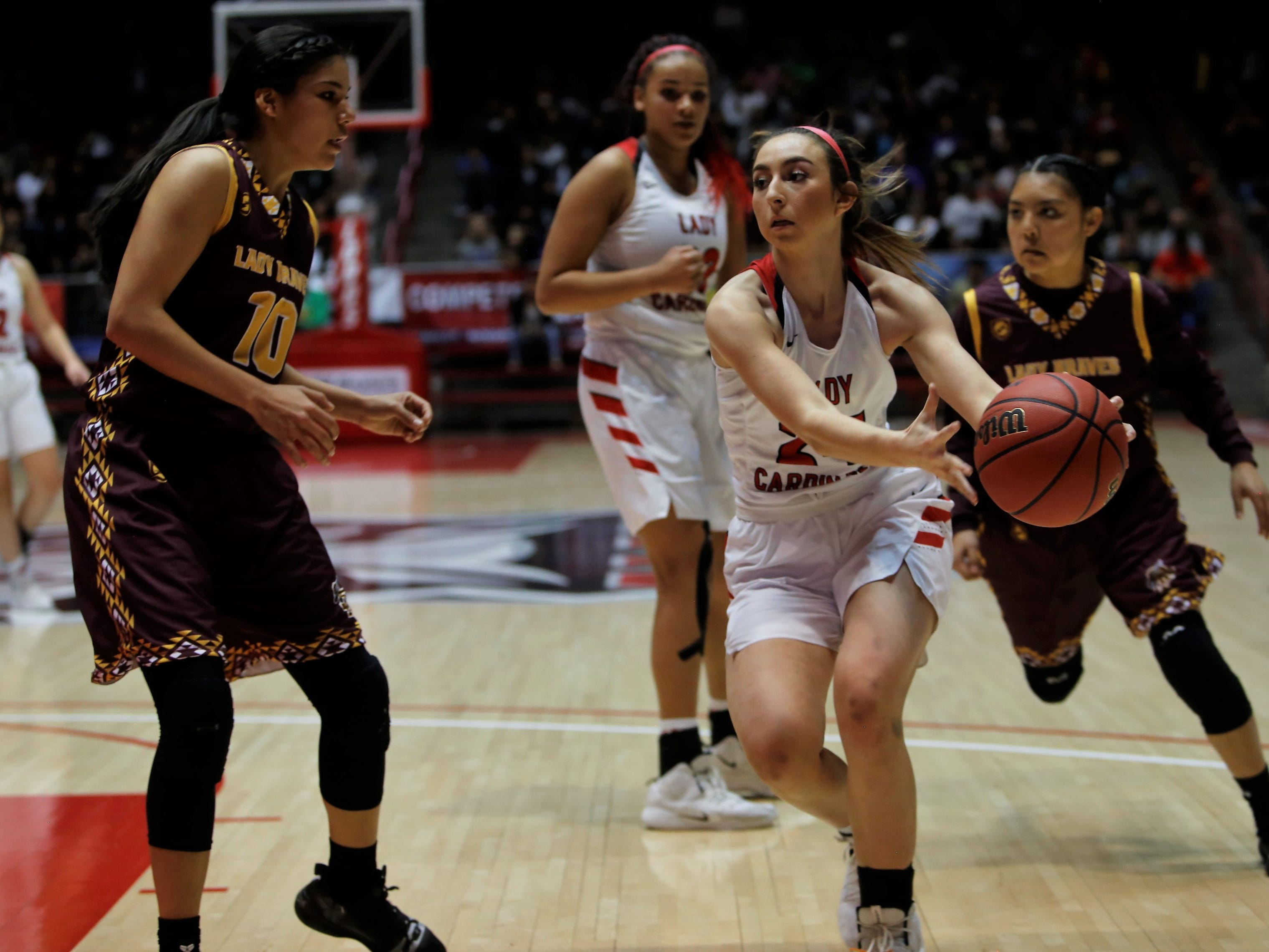 Robertson's Tessa Ortiz drives toward the basket against Santa Fe Indian's Leanna Lewis (10) during Friday's 3A state championship game at Dreamstyle Arena in Albuquerque.