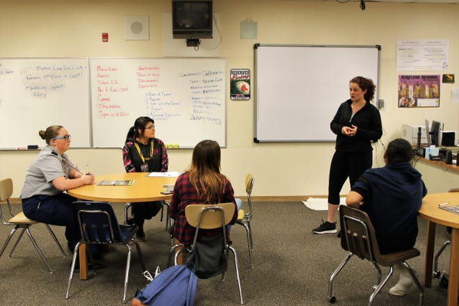 San Juan County Sheriff's Deputy Robin Varela, speaks to Kirtland Central High School students during presentation as part of the Lioness Project on Wednesday.