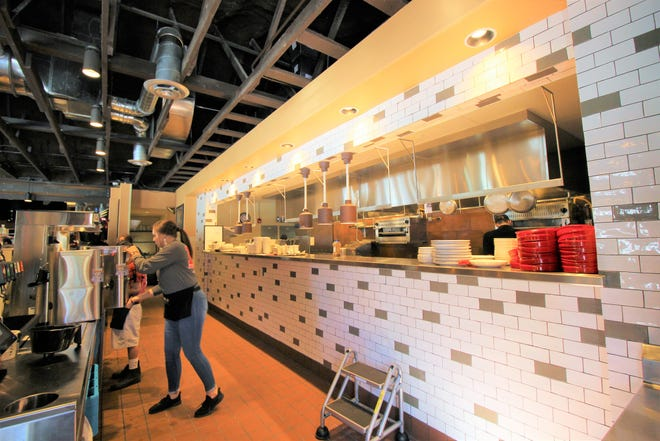 """Farley' renovated kitchen and service stations were created with a """"more open area """" available and has the capacity to serve guests quicker."""