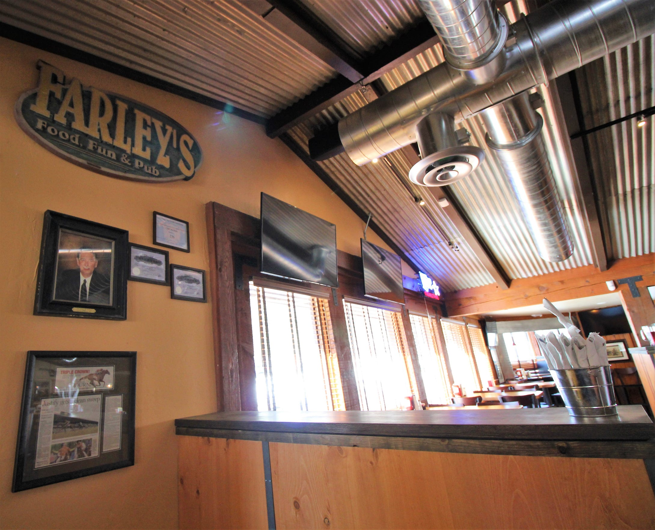 Farley's founder hangs on the wall in the entrance, memorabilia never to be forgotten or misplaced.