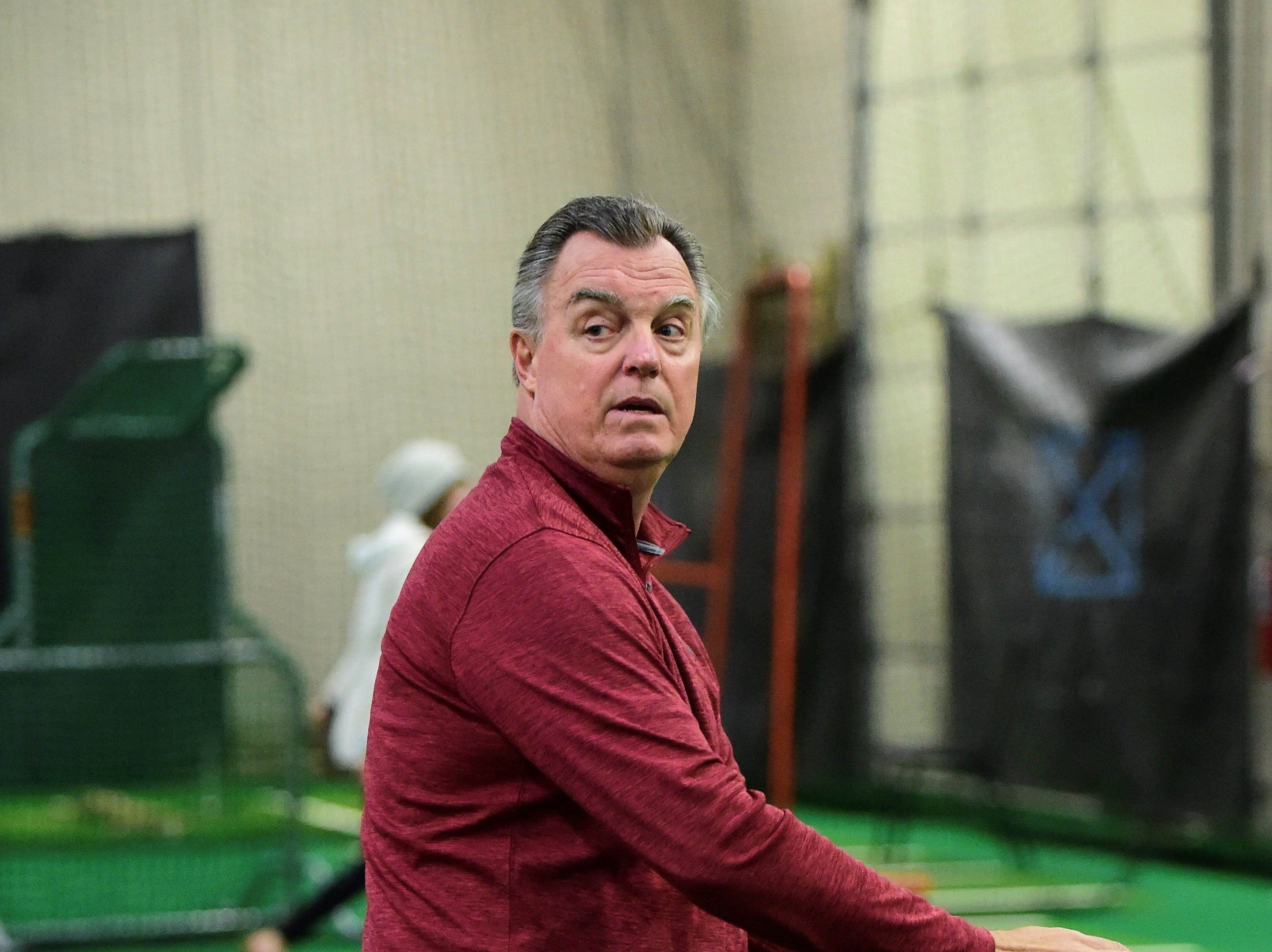 Frank Tanana shows proper pitching form to the Novi Heat players.
