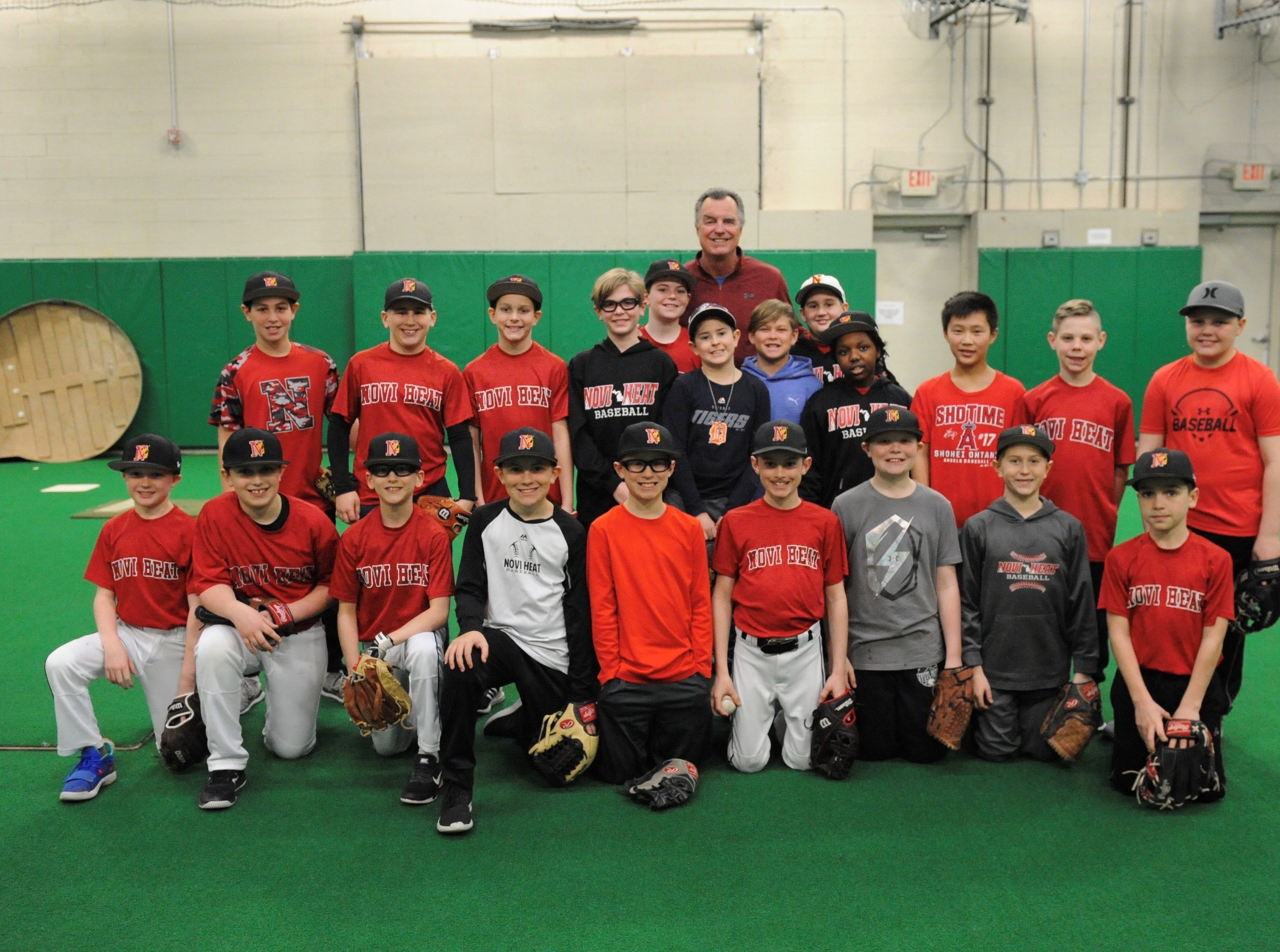 Detroit Tigers retired pitcher Frank Tanana takes a group photo with Novi Heat baseball players Thursday evening.