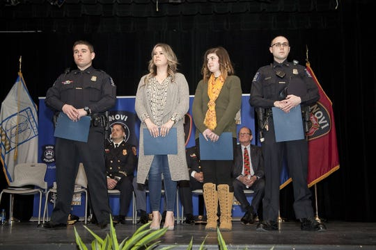 Civilians Genna Guibord and Rachel Hauk are honored along with Novi Police Officers Jason Bergtold and Eric Carlomusto during the Novi Police and Fire Awards, March 7, 2019.