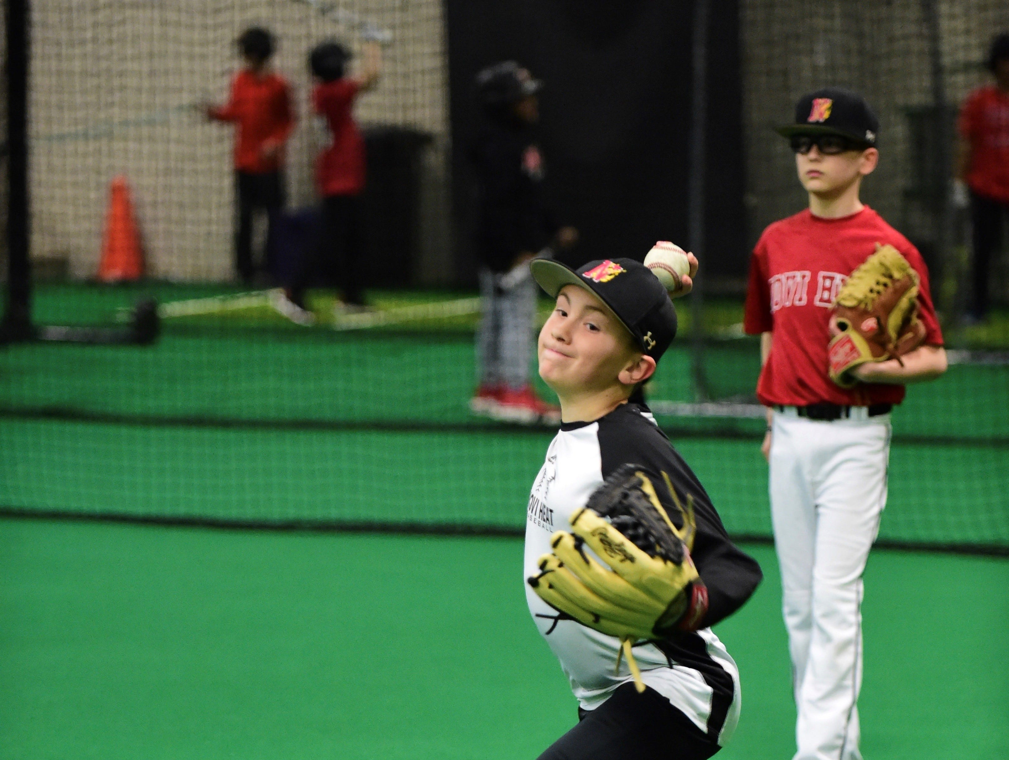 Jacob Durant shows off his pitching form at Thursday'a practice.