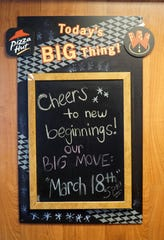 A sign inside the Ford Road Canton Pizza Hut announces its impending move.