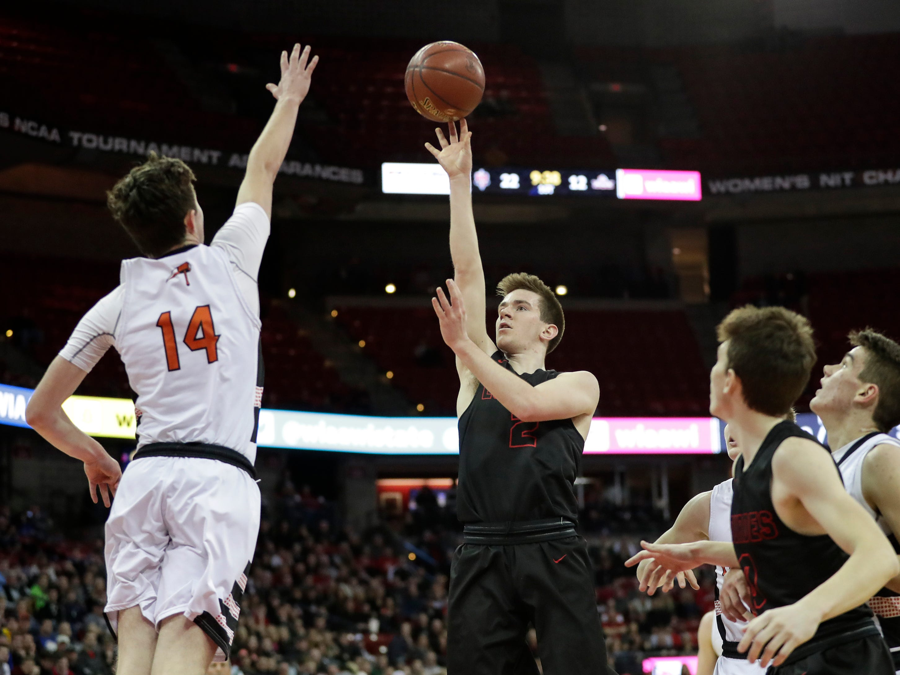 Lourdes Academy's Henry Noone (2) shoots against Osseo-Fairchild High School's Garrett Koxlien (14) during their WIAA Division 4 boys basketball state semifinal at the Kohl Center Thursday, March 14, 2019, in Madison, Wis.
