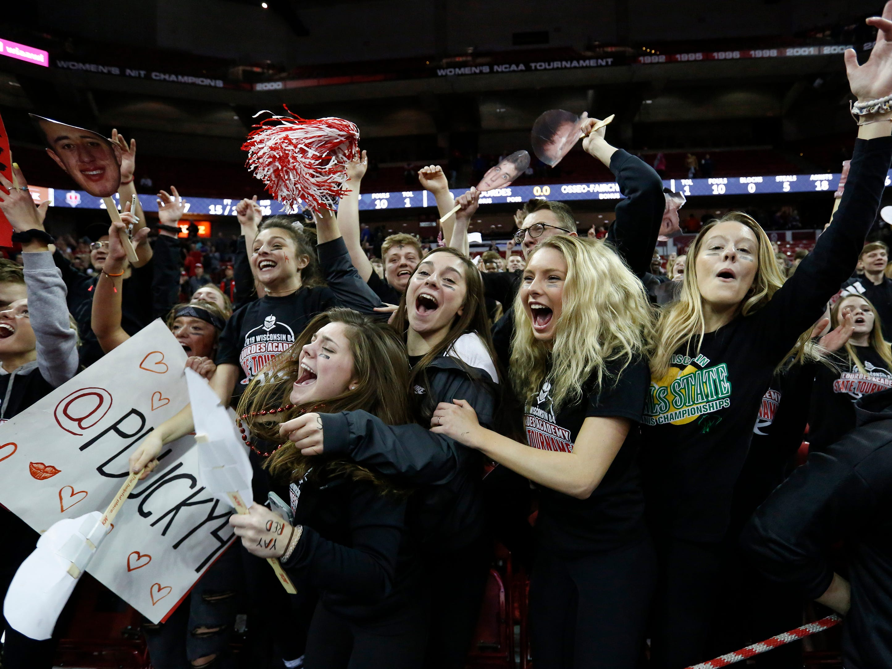 Lourdes Academy's student section reacts after defeating Osseo-Fairchild High School in their WIAA Division 4 boys basketball state semifinal at the Kohl Center Thursday, March 14, 2019, in Madison, Wis.