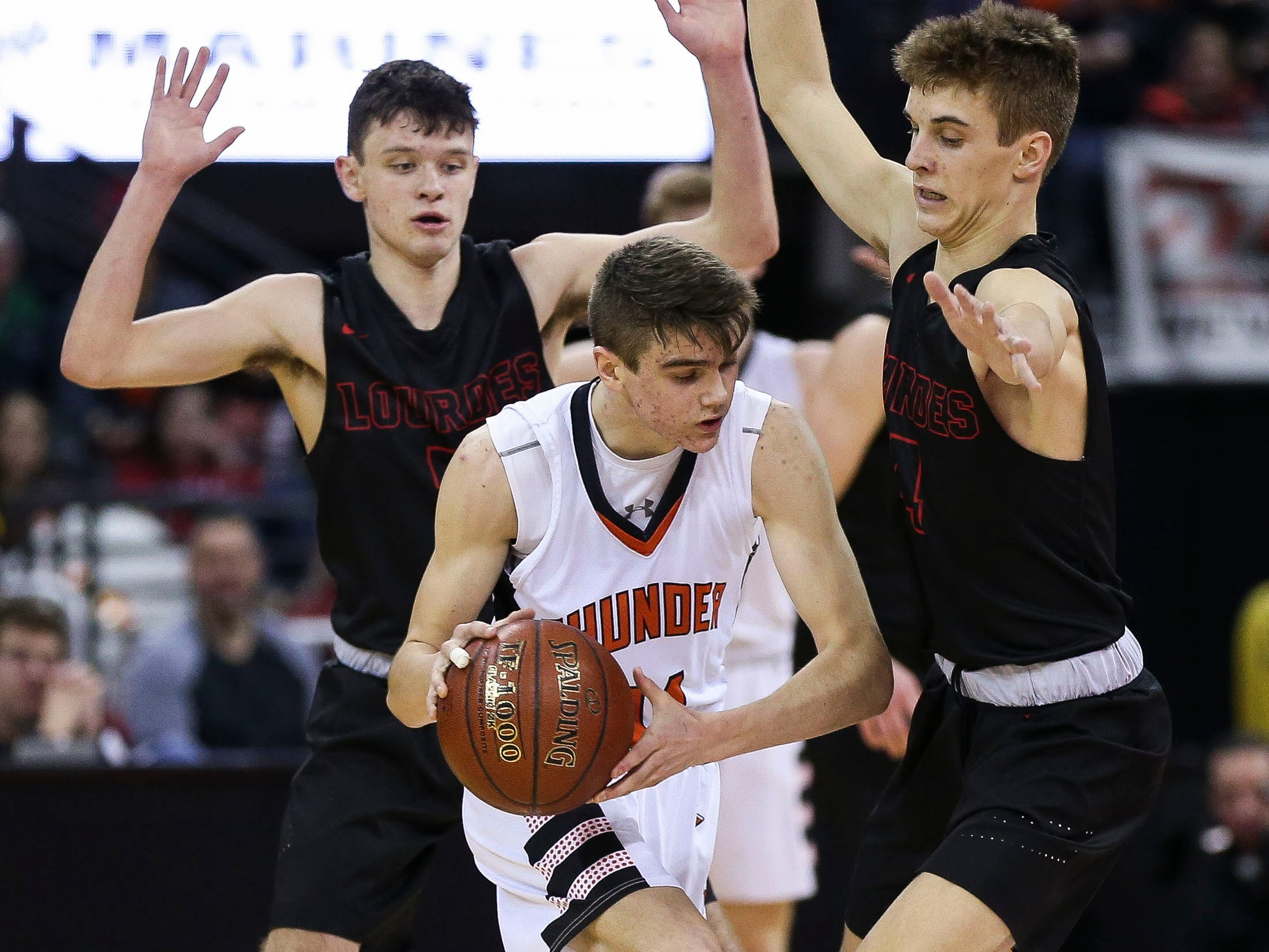 Lourdes Academy's Jack McKellips (5) and Preston Ruedinger (4) trap Osseo-Fairchild High School's Ryan Myhers (11) in a Division 4 boys basketball state semifinal on Thursday, March 14, 2019, at the Kohl Center in Madison, Wis. Lourdes Academy won the game, 70-68, on a go-ahead basket with 1.5 seconds remaining.