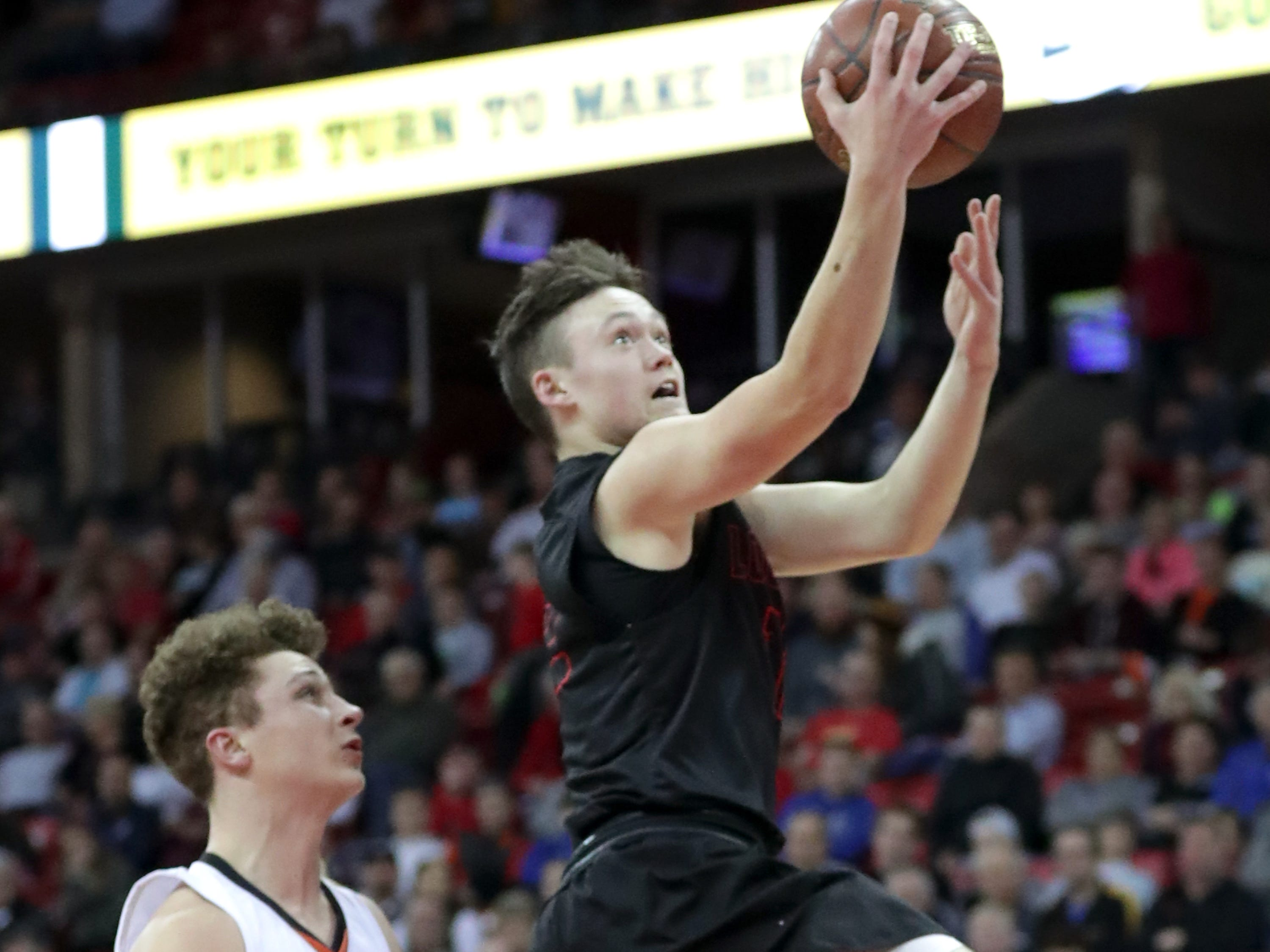 Lourdes Academy's #12 Joshua Bauer drives to the basket against Osseo-Fairchild High School during their WIAA Division 4 boys basketball state semifinal on Thursday, March 14, 2019, at the Kohl Center in Madison, Wis.