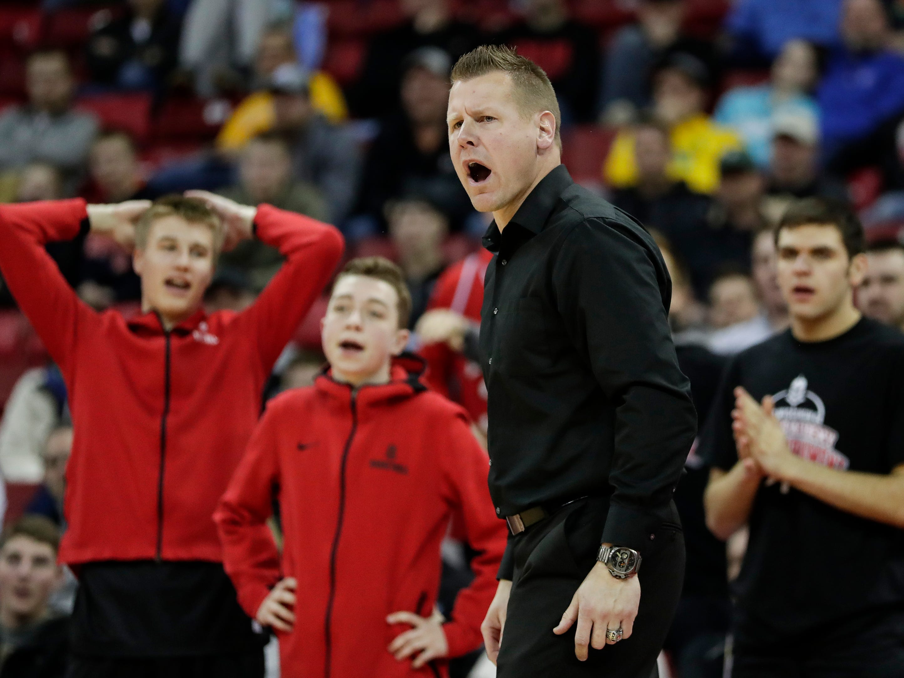 Lourdes Academy's Brad Clark disagrees with a referee's call during their WIAA Division 4 boys basketball state semifinal against Osseo-Fairchild High School at the Kohl Center Thursday, March 14, 2019, in Madison, Wis.
