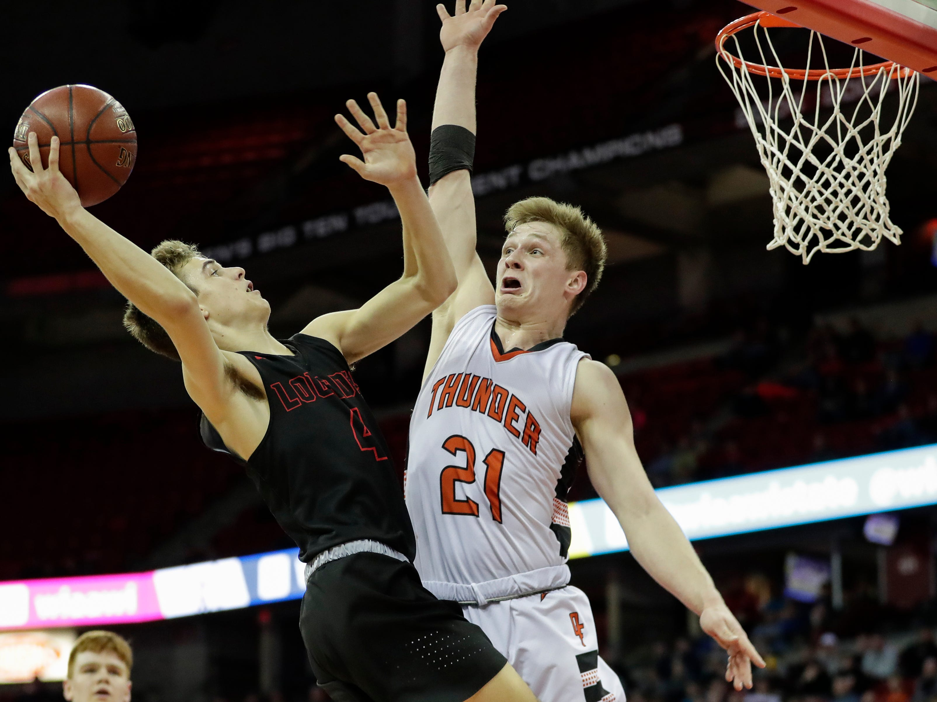 Lourdes Academy's Preston Ruedinger (4) looks to shoot around Osseo-Fairchild High School's Logan Mulhern (21) during their WIAA Division 4 boys basketball state semifinal at the Kohl Center Thursday, March 14, 2019, in Madison, Wis.