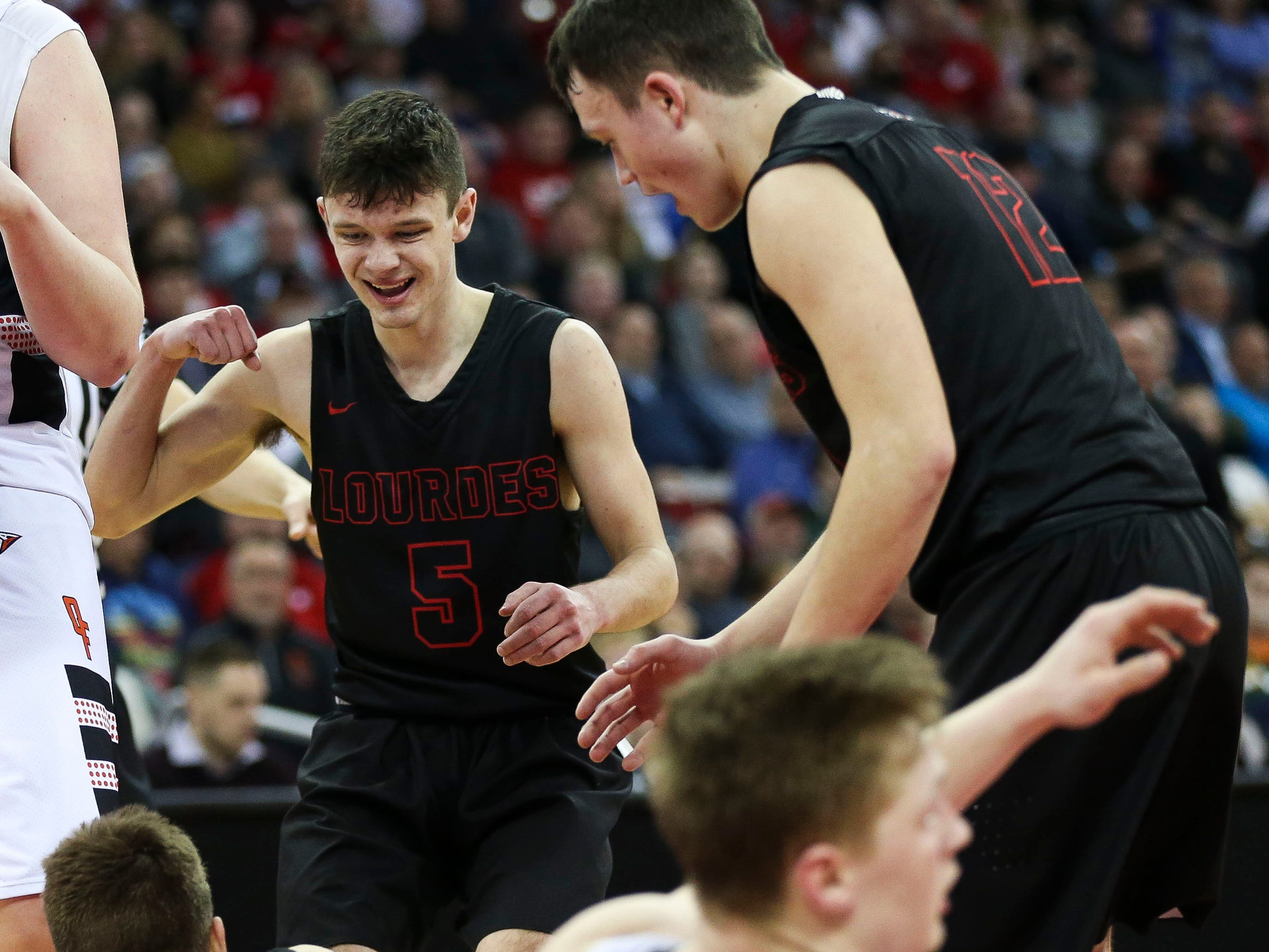 Lourdes Academy's Jack McKellips (5) reacts after a made basket and foul call against Osseo-Fairchild High School in a Division 4 boys basketball state semifinal on Thursday, March 14, 2019, at the Kohl Center in Madison, Wis. Lourdes Academy won the game, 70-68, on a go-ahead basket with 1.5 seconds remaining.