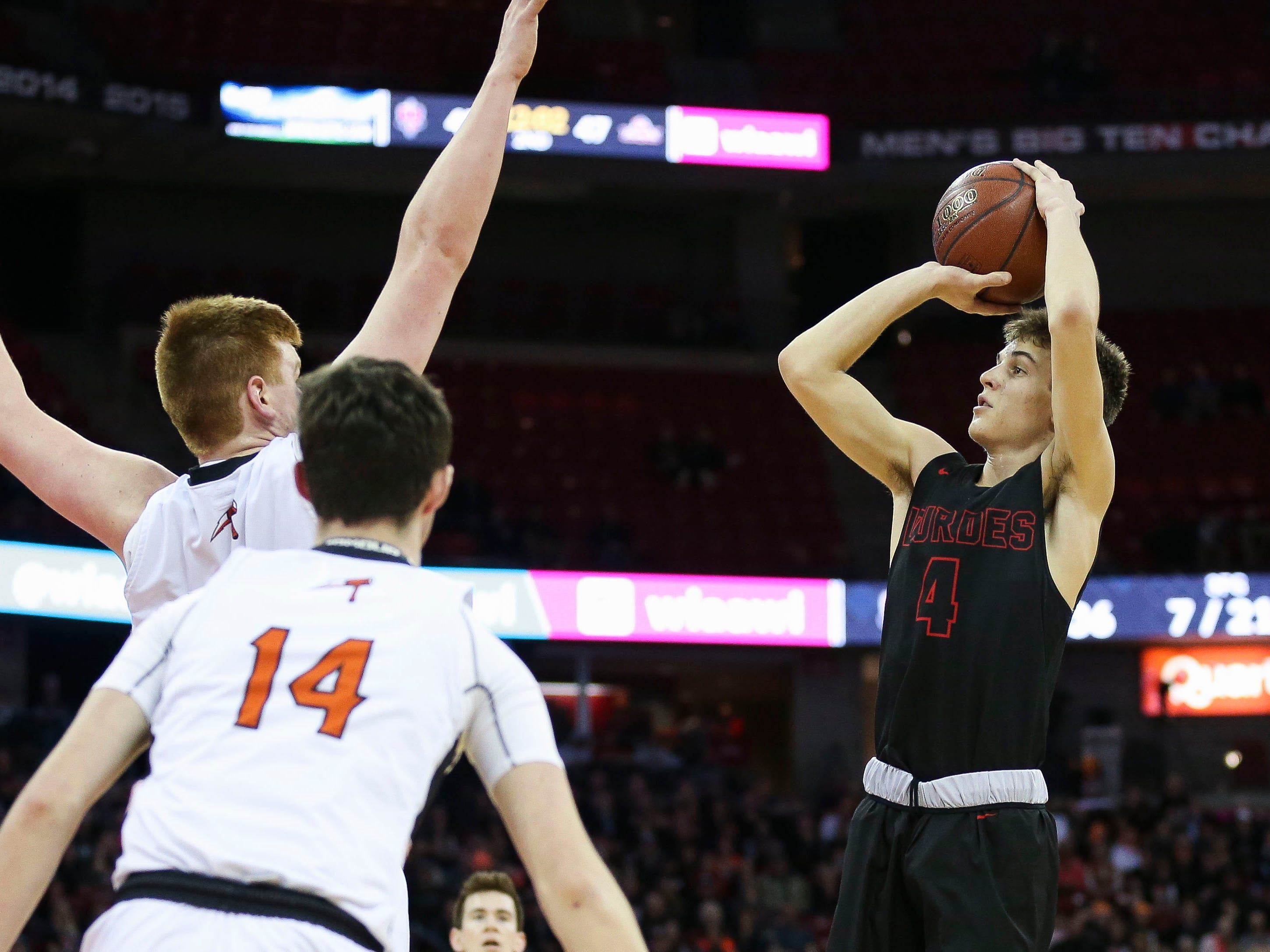 Lourdes Academy's Preston Ruedinger (4) puts up a shot against Osseo-Fairchild High School in a Division 4 boys basketball state semifinal on Thursday, March 14, 2019, at the Kohl Center in Madison, Wis. Lourdes Academy won the game, 70-68, on a go-ahead basket with 1.5 seconds remaining.