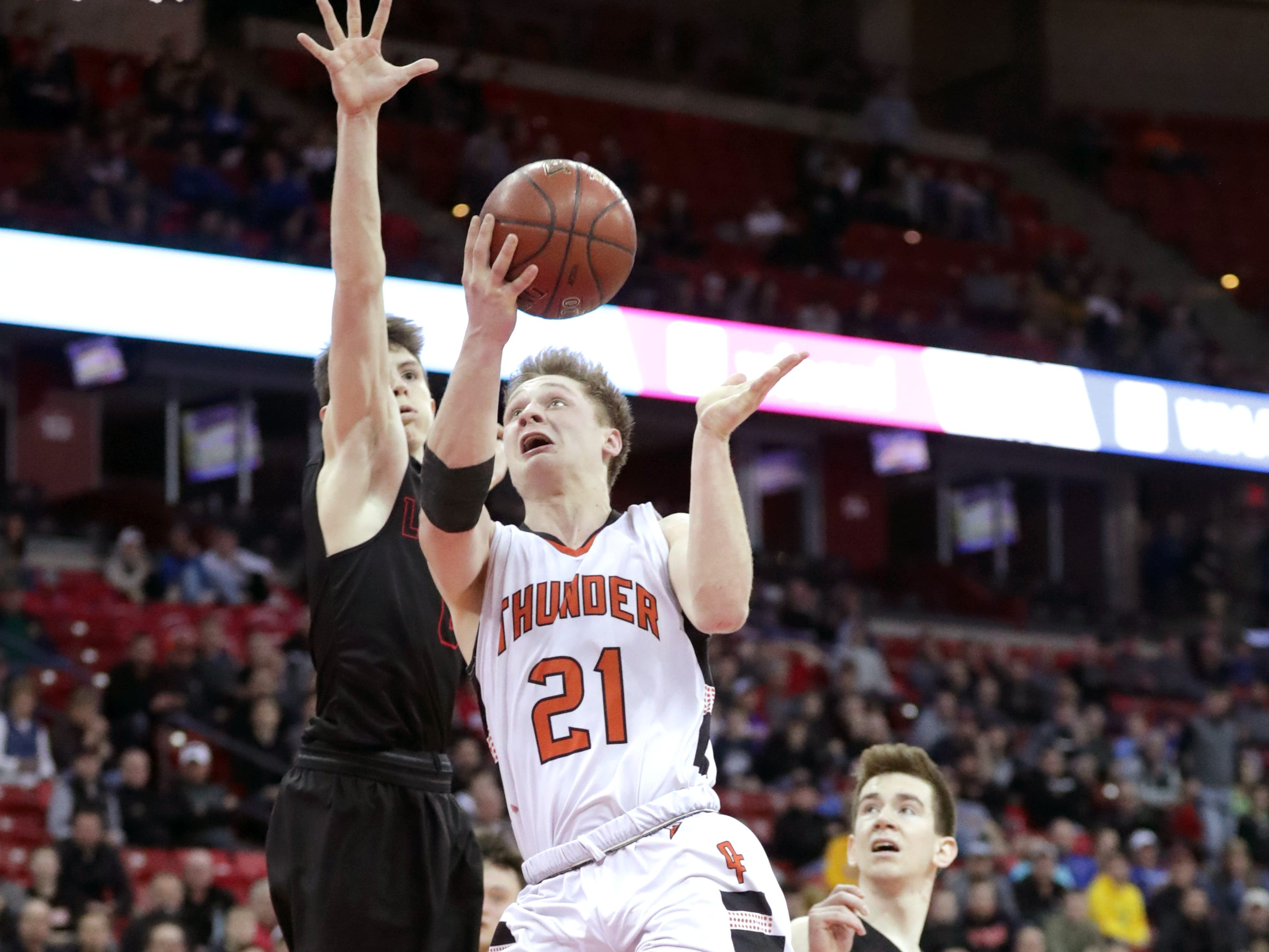 Lourdes Academy's #0 Hayden Jones drives against Osseo-Fairchild High School's #21 Logan Mulhern during their WIAA Division 4 boys basketball state semifinal on Thursday, March 14, 2019, at the Kohl Center in Madison, Wis. Lourdes defeated Osseo-Fairchild 70-68.