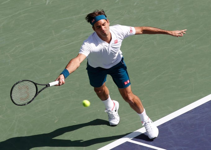 Roger Federer stretches out for.a serve during his quarterfinal match against Hubert Hurkacz on Stadium One at the 2019 BNP Paribas Open at Indian Wells Tennis Garden on March 15, 2019. Federer won 6-4, 6-4.