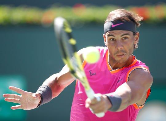 Rafael Nadal returns a shot to Karen Khachanov on Stadium One at the 2019 BNP Paribas Open at Indian Wells Tennis Garden on March 15, 2019. Nadal won the quarterfinal match.
