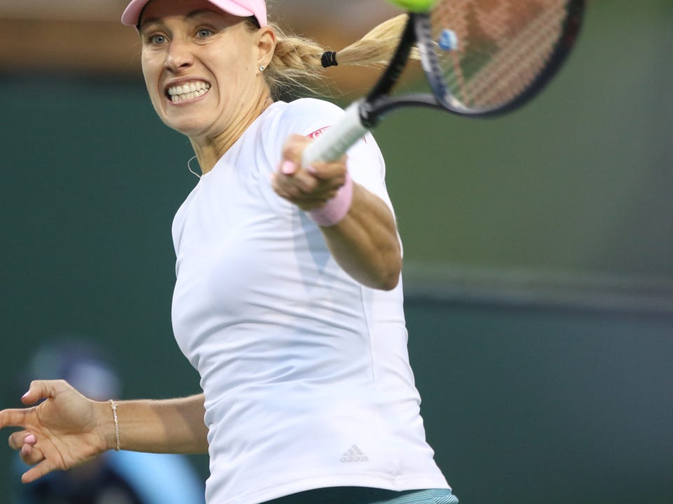 Angelique Kerber returns to Venus Williams during the BNP Paribas Open in Indian Wells on Thursday, March 14, 2019. Kerber won.