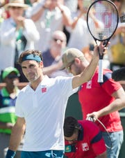 Roger Federer celebrates his quarterfinal match against Hubert Hurkacz on Stadium One at the 2019 BNP Paribas Open at Indian Wells Tennis Garden on March 15, 2019. Federer won 6-4, 6-4.