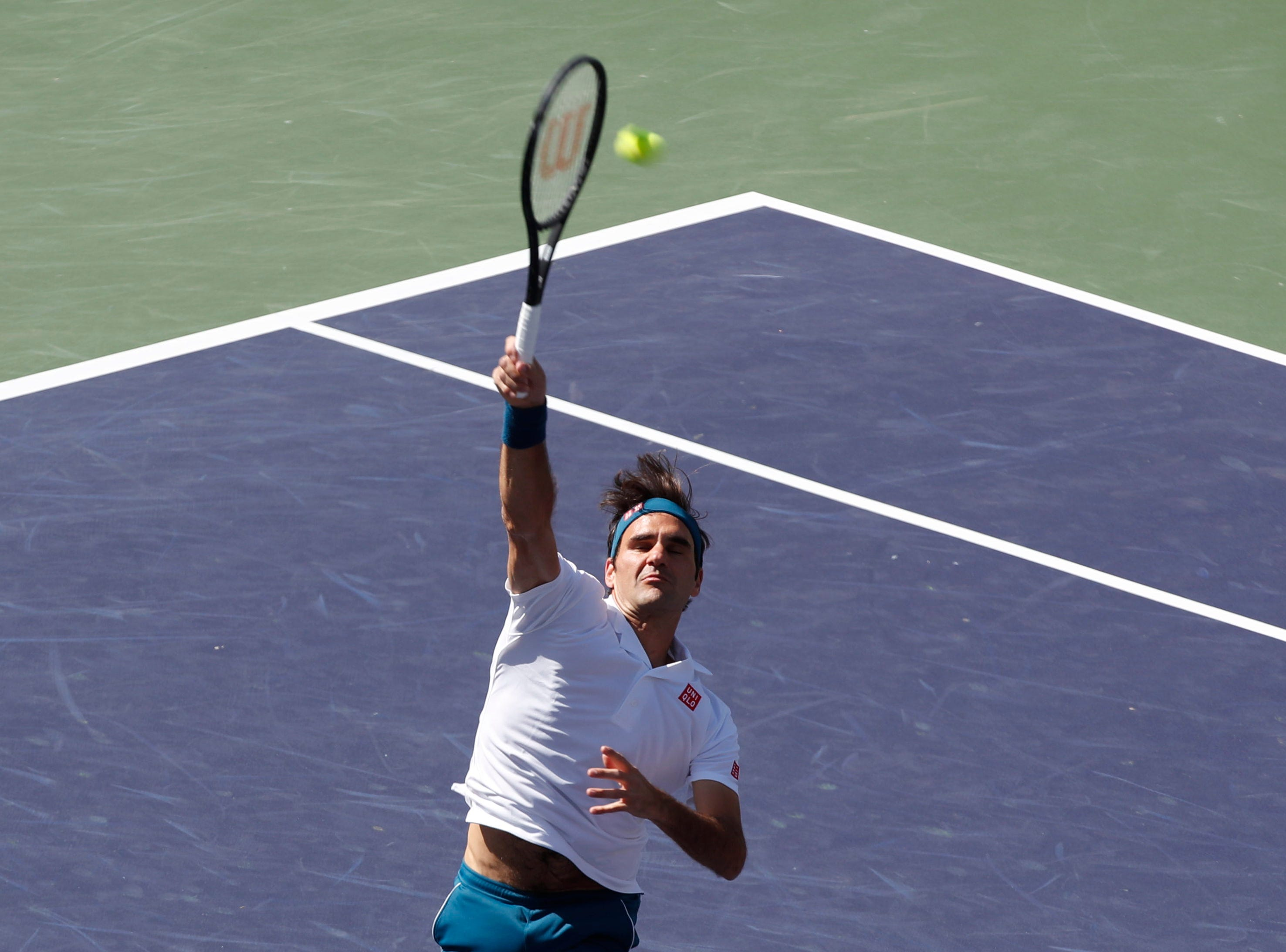 Roger Federer approaches the net during his quarterfinal match against Hubert Hurkacz on Stadium One at the 2019 BNP Paribas Open at Indian Wells Tennis Garden on March 15, 2019. Federer won 6-4, 6-4.