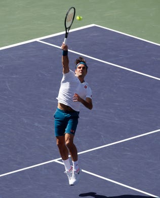 Roger Federer approaches the net during his quarterfinal match against Hubert Hurkacz on Stadium One at the 2019 BNP Paribas Open at Indian Wells Tennis Garden on March 15, 2019. Federer won 6-4, 6-4.