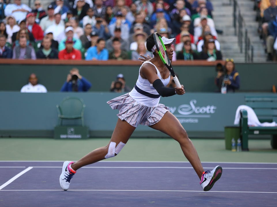 Venus Williams moves towards the net during her match against Angelique Kerber during the BNP Paribas Open in Indian Wells on Thursday, March 14, 2019. Kerber won.