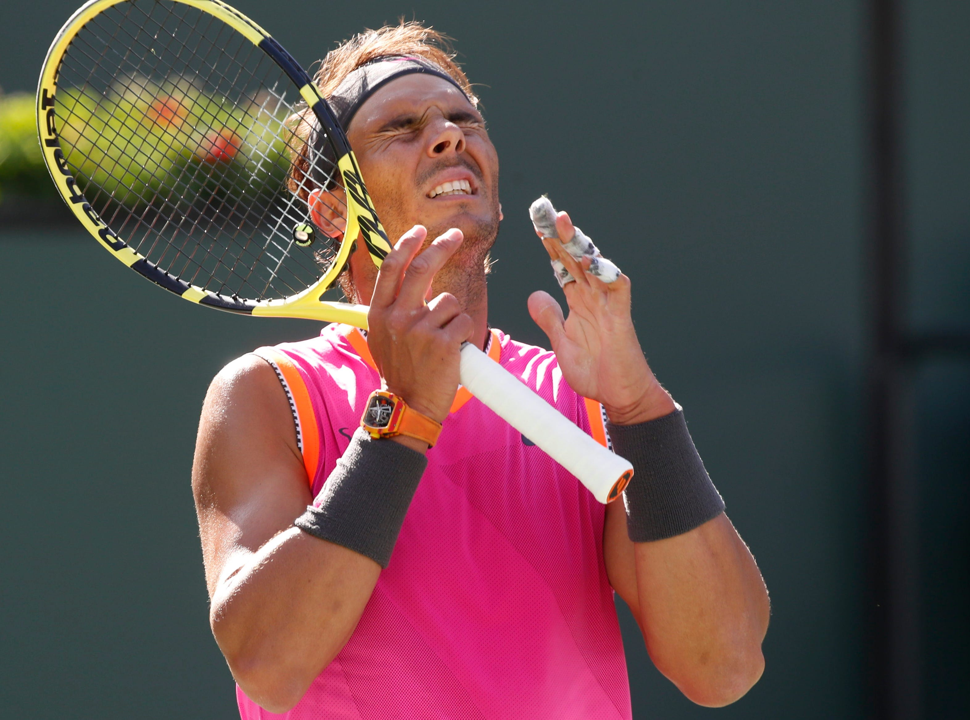 Rafael Nadal laments a play against Karen Khachanov on Stadium One at the 2019 BNP Paribas Open at Indian Wells Tennis Garden on March 15, 2019. Nadal won the quarterfinal match.