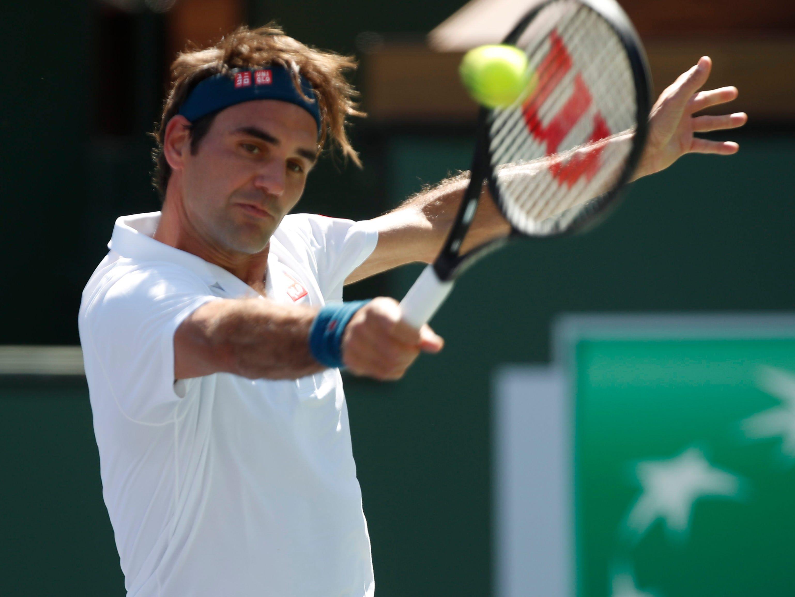Roger Federer hits a backhand during his quarterfinal match against Hubert Hurkacz on Stadium One at the 2019 BNP Paribas Open at Indian Wells Tennis Garden on March 15, 2019. Federer won 6-4, 6-4.
