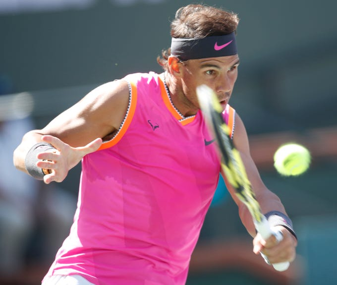 Rafael Nadal returns a shot to Karen Khachanov on Stadium One at the 2019 BNP Paribas Open at Indian Wells Tennis Garden on March 15, 2019. Nadal won the quarterfinal match.