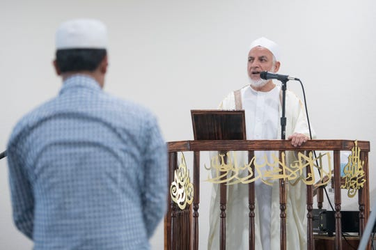 Imam Hosny Ibriham speaks Friday during Jummah at the Islamic Center of Northwest Florida in Pensacola.