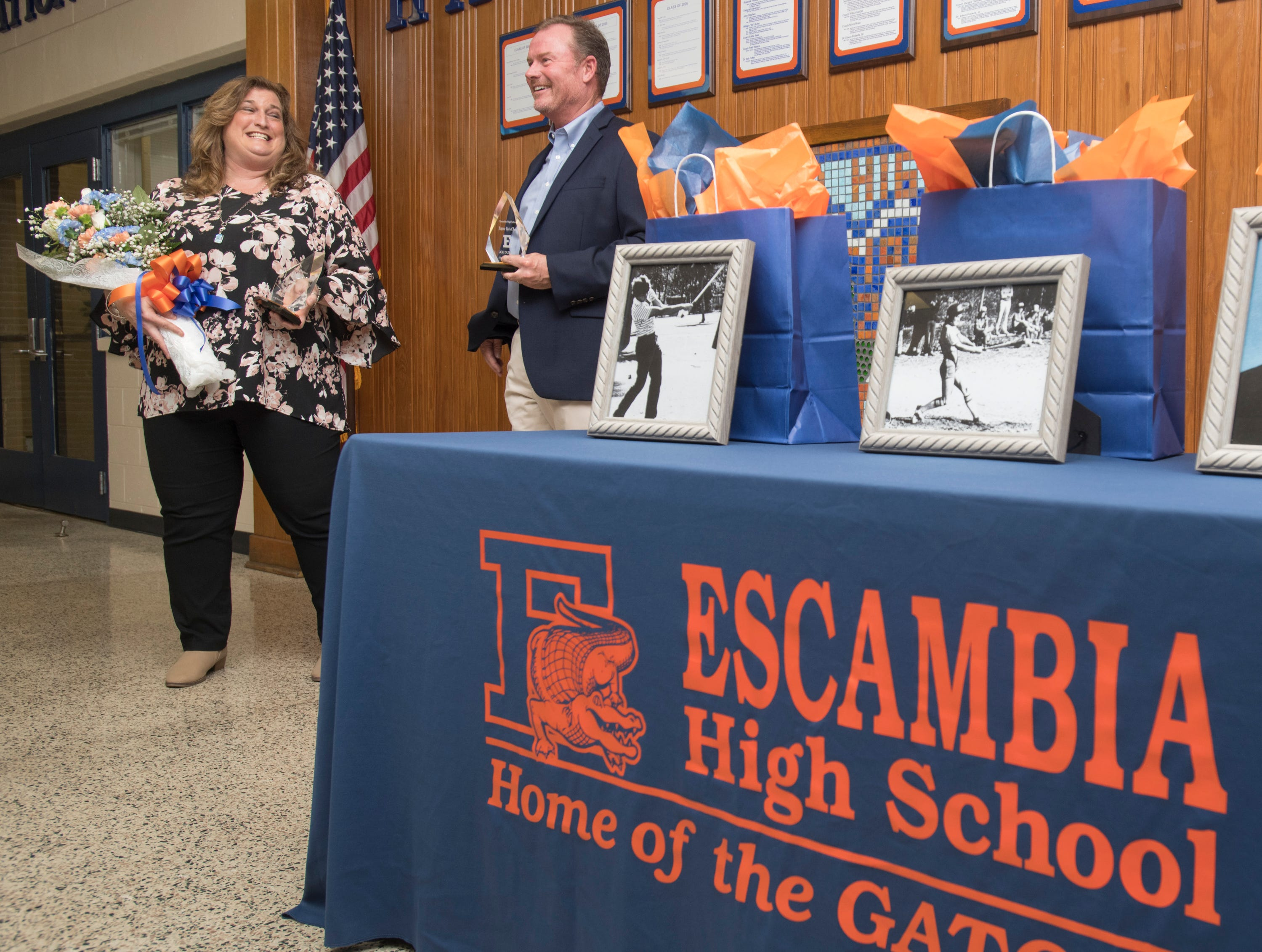 Hall of Fame class of 2018-2019 inductees Cheryl Peters, left, and Joe Durant share a laugh during the ceremony at Escambia High School in Pensacola on March 14, 2019.