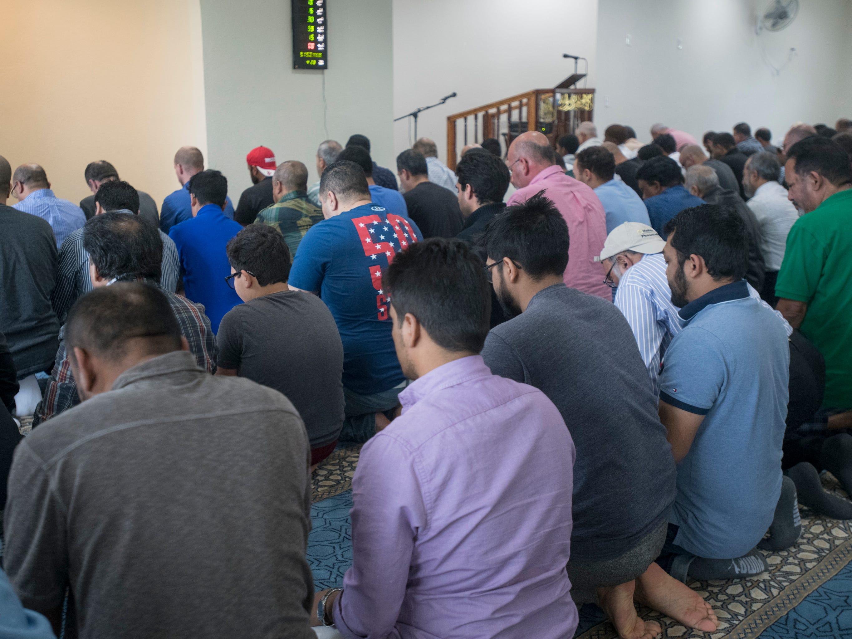 Men pray during Jumu'ah (Friday Prayer) at the Islamic Center of Northwest Florida in Pensacola on Friday, March 15, 2019.