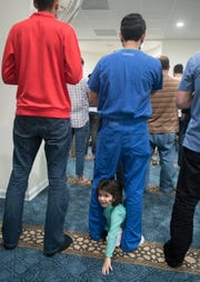 Dr. Danish Ali prays as his son Haris Ali, 2, crawls between his legs during Jumu'ah (Friday Prayer) at the Islamic Center of Northwest Florida in Pensacola on Friday, March 15, 2019.
