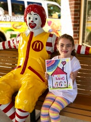 Graysen Sharp, whose family has stayed at the Ronald McDonald House multiple times, designed the organization's Kaps 4 Kids T-shirts.