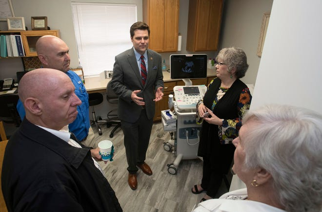 U.S. Rep. Matt Gaetz, R-Fla., gets a tour of the Life Options Clinic in Milton on Friday from the organization's executive director, Cindy Roberts.