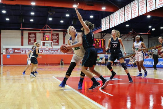 University of West Florida senior Halee Nieman works to take a shot against Eckerd in the first round of the NCAA Tournament in Lakeland on March 15, 2019.