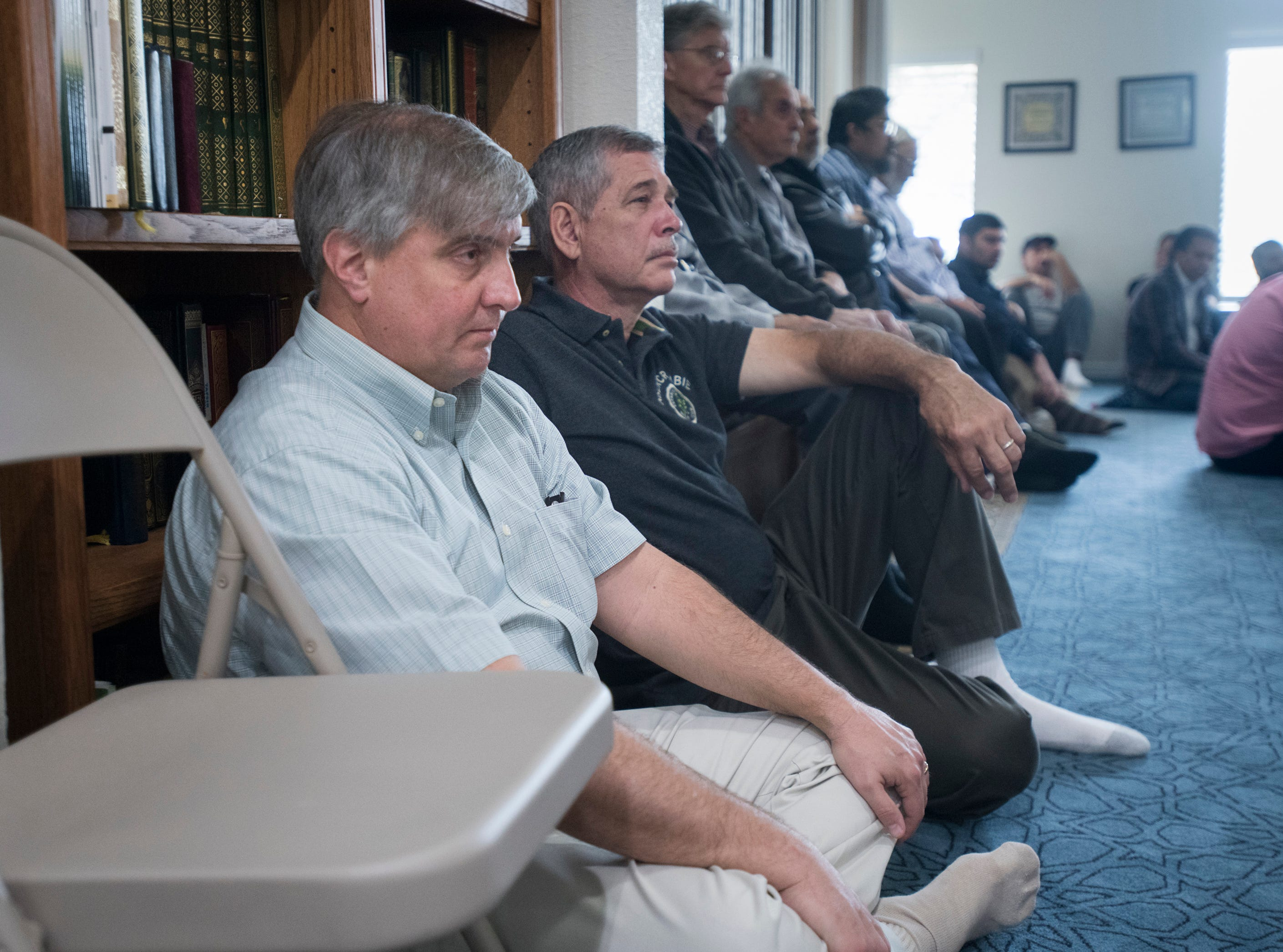 Pensacola Mayor Grover Robinson joins worshipers as they listen to the Imam speak during Jumu'ah (Friday Prayer) at the Islamic Center of Northwest Florida in Pensacola on Friday, March 15, 2019.  The Mayor expressed his support for the Muslim community following the New Zealand mosque massacre.