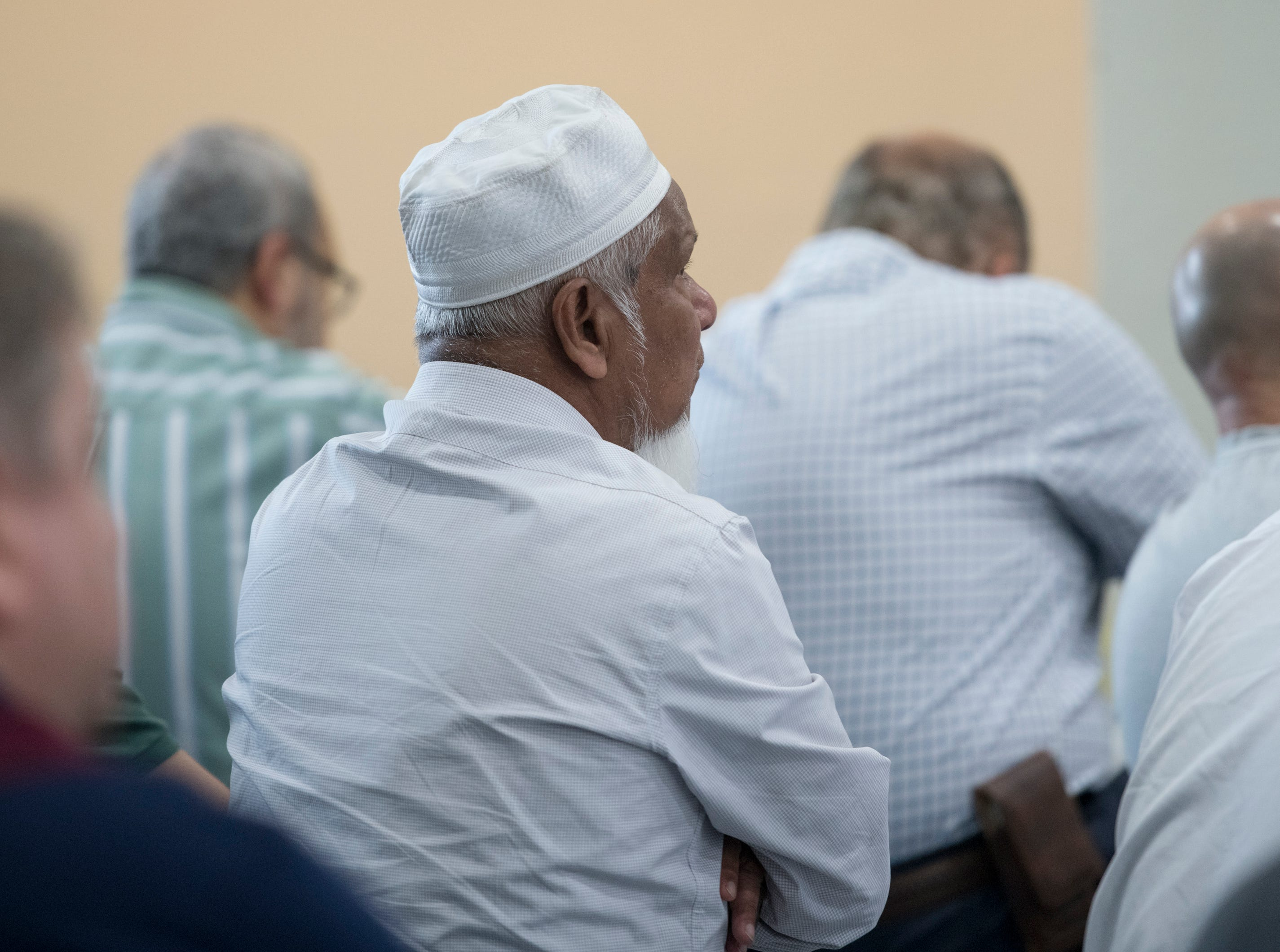 Worshipers listen to the Imam speak during Jumu'ah (Friday Prayer) at the Islamic Center of Northwest Florida in Pensacola on Friday, March 15, 2019.