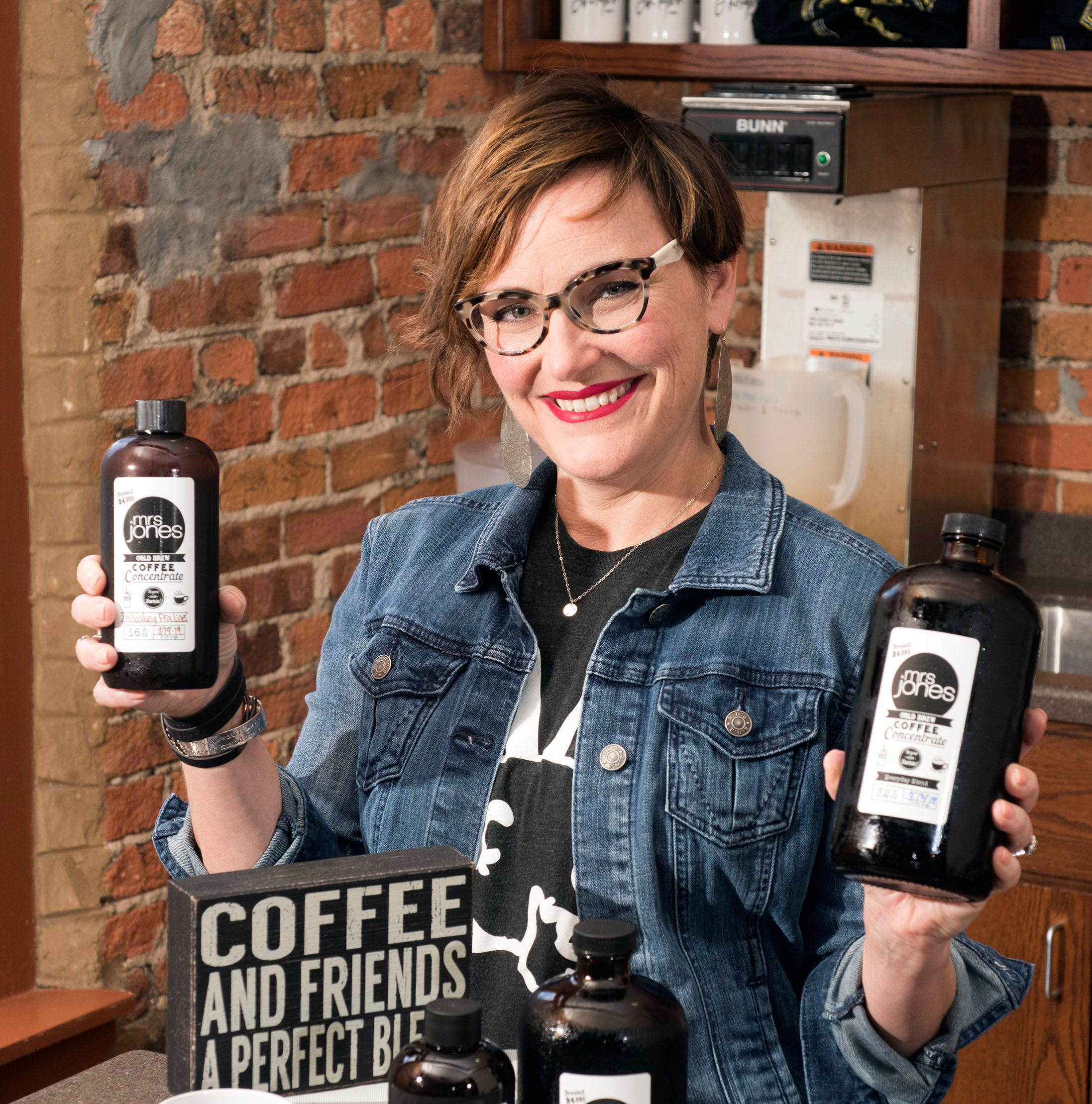 Pensacola resident Stephanie Jones shows off her cold brew coffees on Friday, March 15, 2019. Jones has found a market for her cold brew concentrates at a variety of local businesses and the Palafox Market on Saturday's in downtown Pensacola.