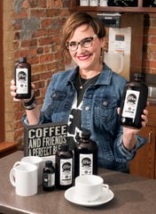 Pensacola resident Stephanie Jones shows off her cold brew coffees on Friday. Jones has found a market for her cold brew concentrates at a variety of local businesses, as well as at the Palafox Market.