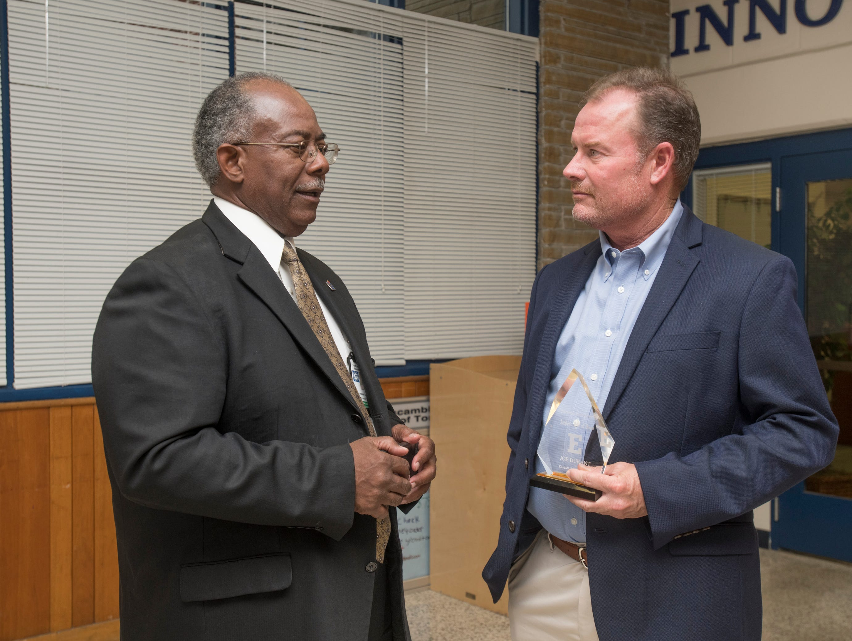 Deputy Superintendent Norman Ross, left, chats with Hall of Fame class of 2018-2019 inductee Joe Durant at Escambia High School in Pensacola on March 14, 2019.