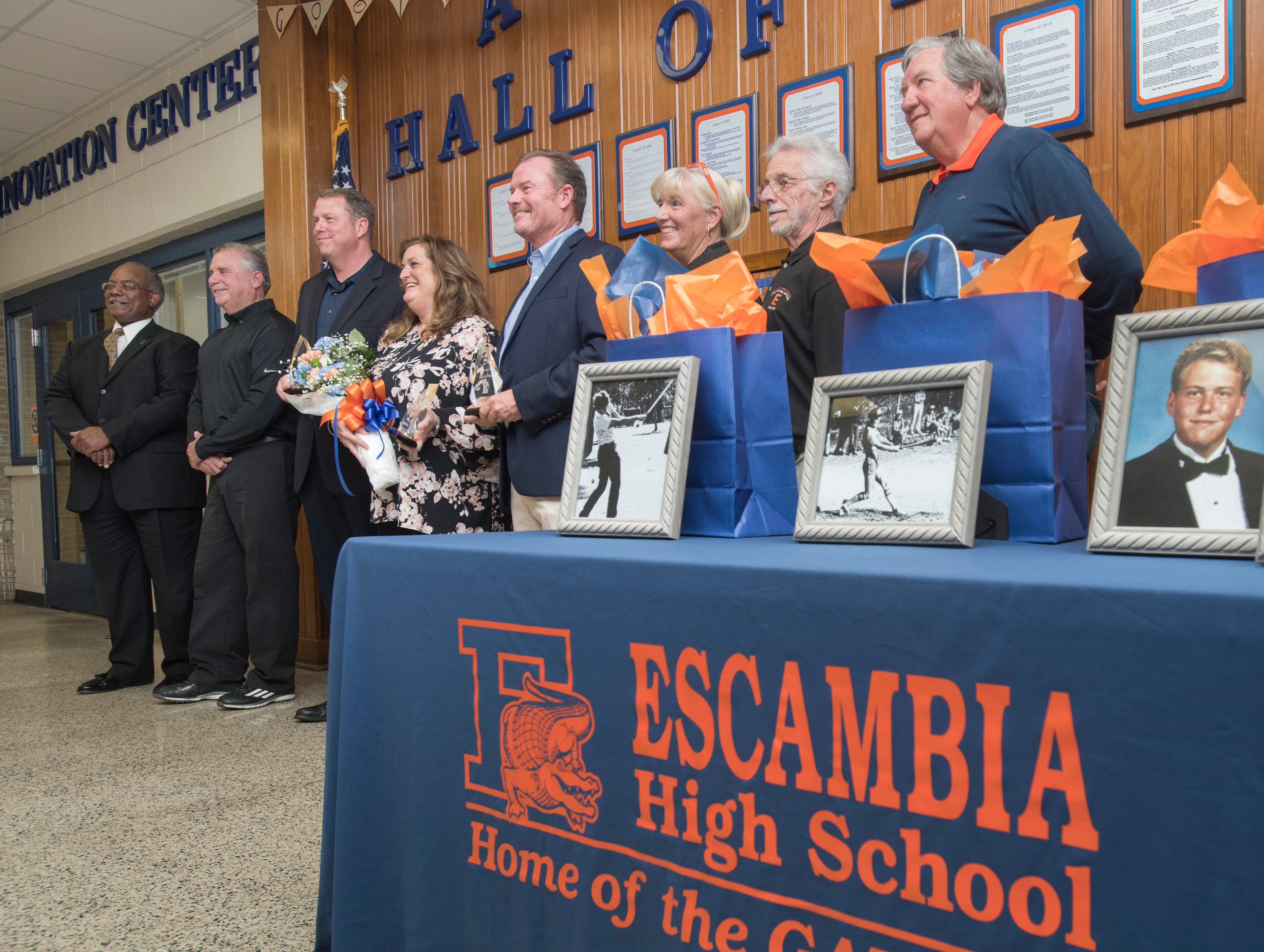 New and previous Hall of Fame inductees pose at Escambia High School in Pensacola on March 14, 2019.